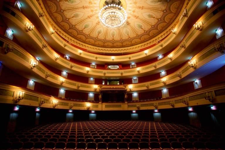 Panoramic view of an illuminated empty auditorium of the Gärtnerplatztheater in Munich.