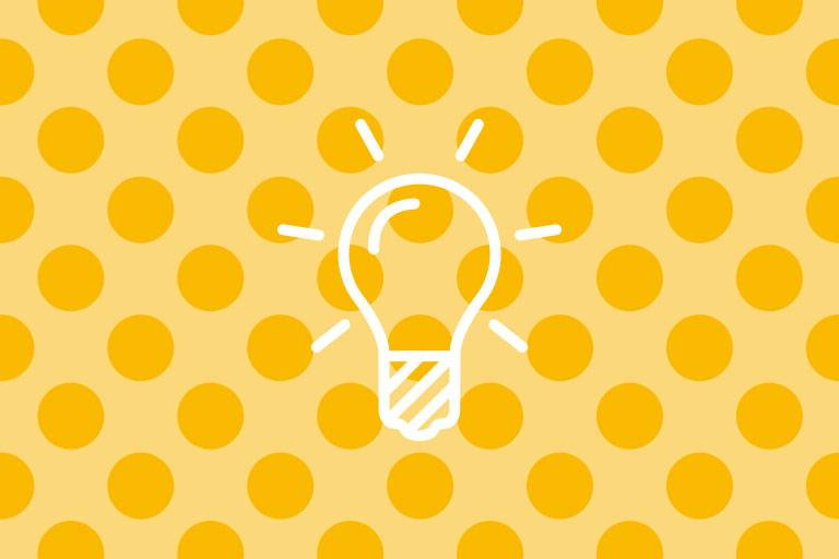 Glühbirnen-Icon auf gelber Struktur