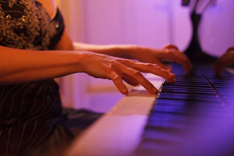 A woman is playing the piano.