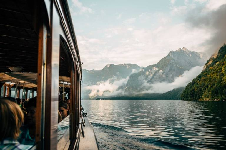 Boat trip at the Königssee with panoramic view of the Alps in the surroundings of Munich.