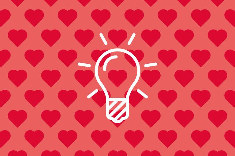 Bulb-Icon on a red background with hearts