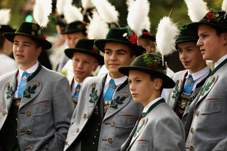 A group of young men dressed in traditional costumes at the Oktoberfest in Munich.