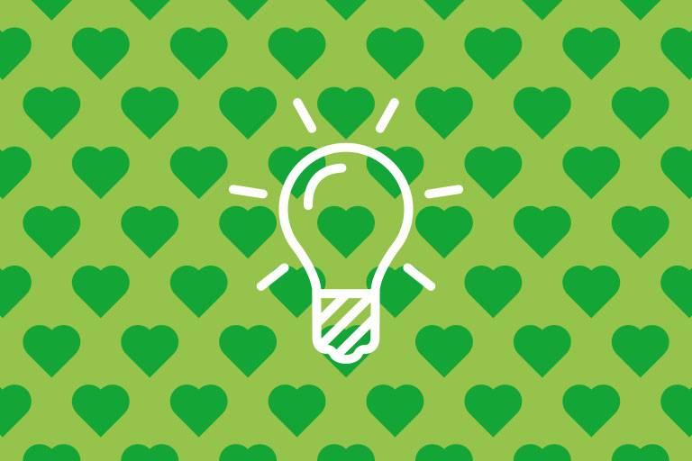 Glühbirnen-Icon auf grüner Struktur