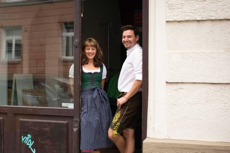 Employees of Munich Tourism in costume in the Bavarian Outfitters in Munich